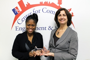 Adams (left) and Campos received the Septima Clarke Empowering Children and Communities Award from local nonprofit nonprofit MOMIE's TLC.
