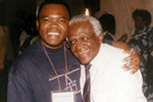 Photo of Rev. Ngoy D. Mulunda-Nyanga and Archbishop Desmond Tutu smiling in a warm embrace