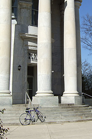 Photo of front steps of McKinley Building on AU's main campus, with bicycle leaning on the steps
