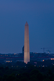 Photo of the Washington Monument and the Washington, DC skyline at night.