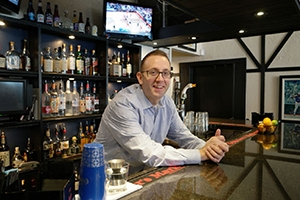 Chris Nardelli behind the bar at Blue44