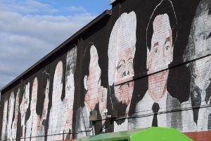A mural of famous people of Black culture at the East River Park Shopping Center.