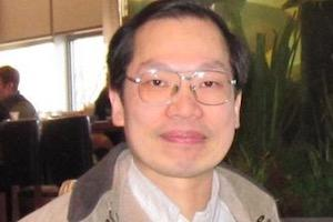Headshot of Professor Huang