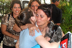 American University student Allison Boyle hugs her relatives in Cuba.