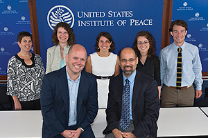 Alumni at USIP, back row, from left, Susan Douglas '78, graduate student Maria Jessop, Shira Lowinger '05, Elizabeth Detwiler '07, Charles Martin-Sheilds '05, and front row, Ian Larson and David Smith '82