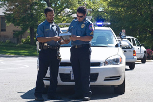 Two Public Safety Officers and Patrol Car
