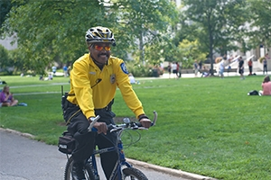 Safety officer riding a bicycle on campus