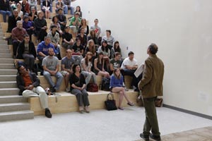 Paul Wapner addresses a packed house in the new SIS building, April 22. (Photo: Rick Reinhard)