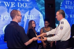 Police Chief Peter Newsham with students