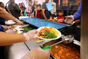 students getting school lunches on line