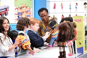 Darla Davenport-Powell and kids playing with Niya doll