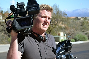 David Grant (SOC '12) on location with his camera in Phoenix with the show Property Wars.