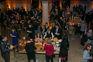 A crowd gets catering at the Embassy.