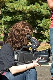 Discover the World of Communication student works on camera technique.