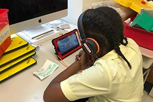 A child studies another language with headphones
