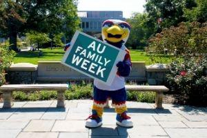 Clawed holding Family Week sign