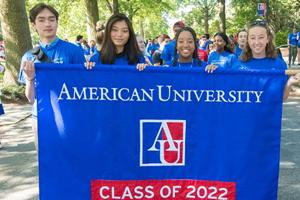 Four students holding up an AU banner for the class of 2022.