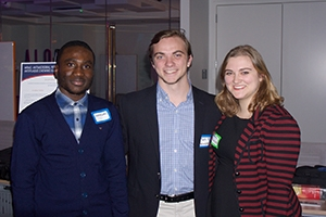 Graduate student Emmanuel Mayegun-Adola, and undergraduates Mutt Mullin and Samantha Hepworth at the Booz Allen Hamilton Innovation Center