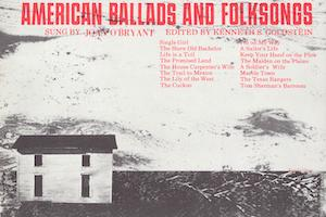 Black and white house on a field. American Ballads and Folksongs