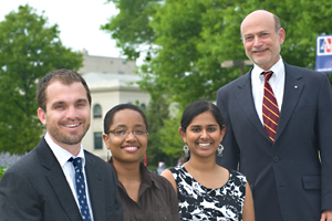 (Left to right) 2011 Fulbright recipients Ben Williams (SIS/MA '11), Kia Hall (SIS/PhD '13), and Divya Narayanan (SIS/BA '11) with Dean Louis Goodman. Photo by Jeff Watts.