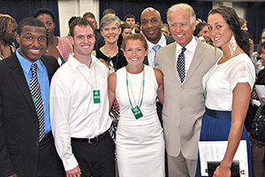 OCL VP Gail Hanson, athletics director Keith Gill, and student-athletes with US Vice President Joe Biden.