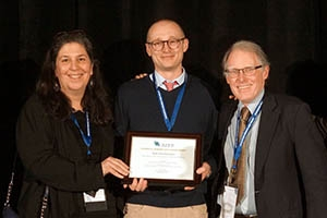 Seth Gershenson, center, accepts the award for Best Research Article.