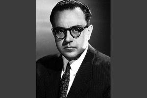 Man in a suit and tie with glasses