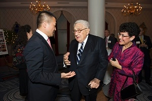 Gloria Gonzalez-Micklin with Dr. Henry Kissinger