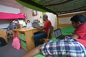 Students lounge in their residence hall room.
