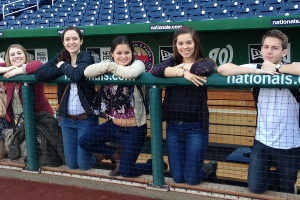 The Green Eagles take a break in the Nationals dugout during a tour of the green features of the LEED-certified ballpark