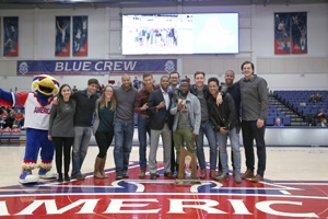 Hendra (pictured fourth from left) and his teammates at American University celebrating the 10th anniversary of the Patriot League championship.