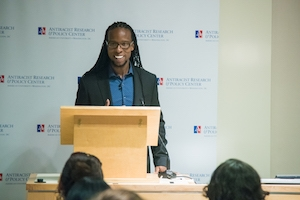 Professor Ibram Kendi stands at podium