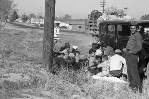 Mexican migrant workers wait on the side of the road near Bakersfield, California in 1936.