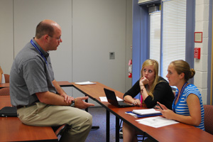 Dr. Peter Howard (left) chats with some Washington Community of Scholars students in summer 2009.