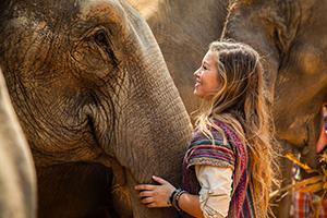Hyatt Mamoun stands with elephant