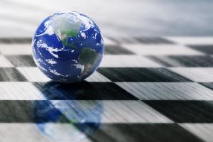 Globe atop a chess board