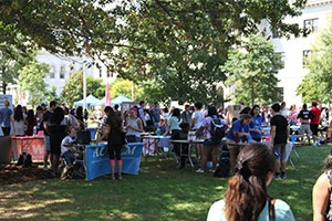 Students gathered around the student clubs and organizations on the Eric Friedheim Quad during the Involvement Fair.