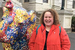 Isabel with the speckled elephant in front of Hurst Hall