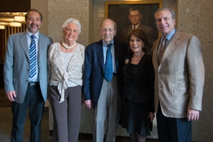 The late Jack Kay (center) stands with family in front of his father's portrait at the Abraham S. Kay Spiritual Life Center's rededication in fall 2012.