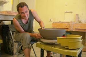 SIS professor Jesse Ribot at a pottery wheel.