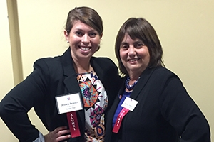 Jessica Beasley and Pat Oltmann pose at the SPA student-alumni networking reception.