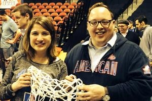 Joe Vidulich, SPA/BA '08, holds the net from the Patriot League Championship with fellow Alumni Board member Andrea Agathoklis Murino, SPA/BA '98