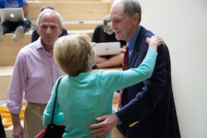 Joe Eldridge greets a guest at his retirement ceremony.
