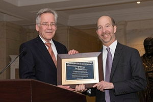 SPA Professor Jon Gould accepts the Administration of Justice Award.