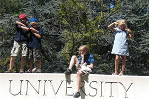 Children posing on an AU sign
