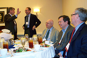 Photo: Wendell Cochran, Charles Lewis, and Larry Kirkman at the Investigative Reporters and Editors Conference luncheon sponsored by AU. In the background, Mark Horvit, right, and Brandt Houston