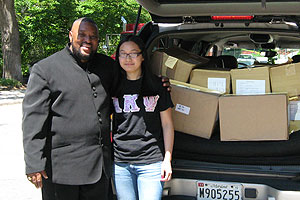 Kogod Student donating used Career Development textbooks to Marshall Heights Community Development Organization