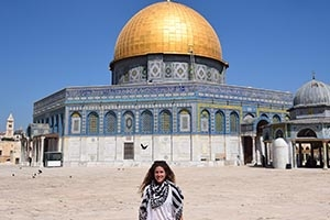 Kim Maldonado standing in front of the Dome of the Rock in Israel.