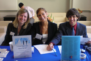 Photo. From left: Annie Genevish, corporate relations manager at Kogod's Center for Career Development, and juniors Elizabeth Watson and Chris Veasey at Consulting Day