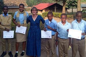 Peace Corps volunteer with school children in Rwanda